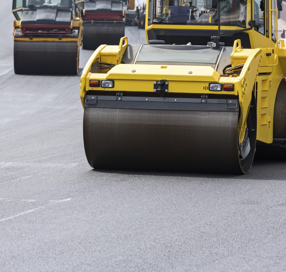 Compactor roller during asphalting works at road construction