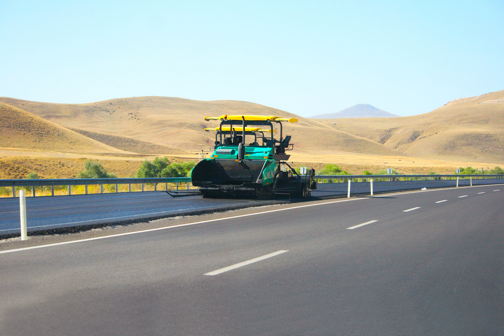 Asphalt Paving Machine On Mountain Road In Turkey.