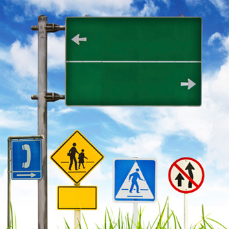 Traffic-signs-on-green-grass